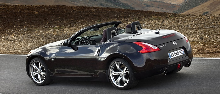nissan 370z roadster 3.7 v6 vs jaguar xk convertible 5.0 v8 - automaniac